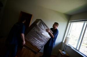 Professional movers shrink wrapped and treated with care.